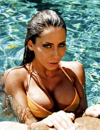 Ravishing babe with tanned skin revealing her big boobs at the poolside - part 2