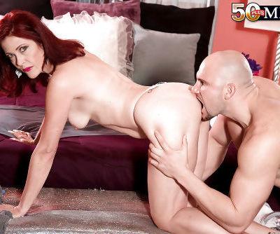 Small boobed mature redhead Dana Devereaux taking hardcore facial cumshot