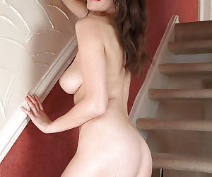 Busty housewife Katie flashes panties under skirt on stairs - part 2