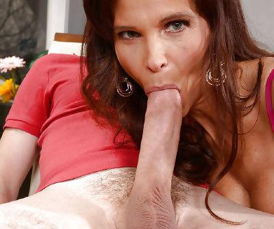 Chesty cougar Syren De Mer flashing upskirt panties while giving blowjob