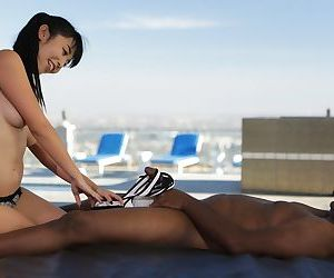 Japanese masseuse Marica Hase seduces a black client during a massage