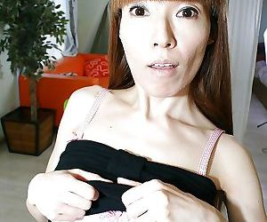 Slim MILF Yoshie Hirai getting naked and spreading her legs in stockings
