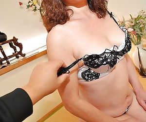 Asian mature lady strips down and gets her twat teased with a sex toy
