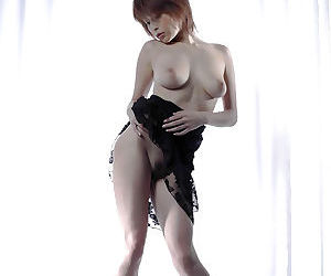 Busty asian babe Nana Natsume slowly uncovering her tempting curves