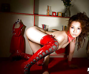 Asian sweetie Tatsumi Yui posing topless and slipping off her red panties