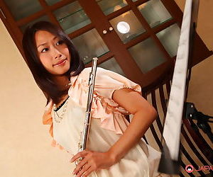 Charming Japanese MILF Yayoi Yanagida posing with a flute in sexy outfit