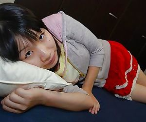 Smiley asian teen Miyuki Itou undressing and expposing her cunt in close up