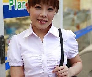 Beautiful Japanese woman Ai Yoneyama posing in public in tight pencil skirt