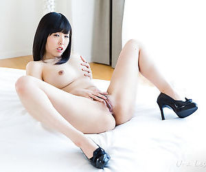 Teen Asian girls romp naked together petting each others firm breasts