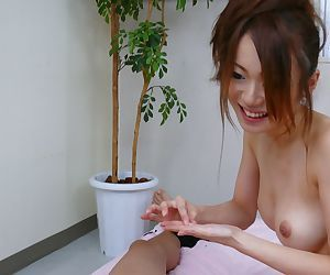 Hot Japanese masseuse Sara Seori does two Asian cocks during the treatment