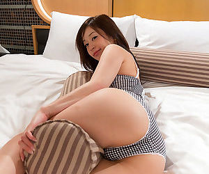 Japanese hottie cleans the jism from her fingers after stroking a cock