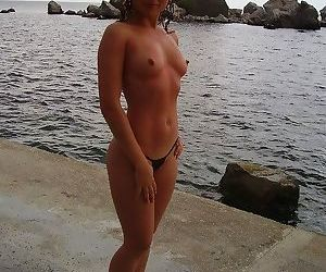Shaved sexy nudist redhead milf posing outdoors - part 3056