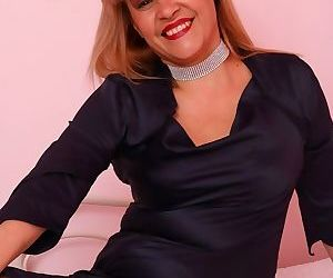 Ruby stone mature blonde in black stockings stripping on bed - part 15