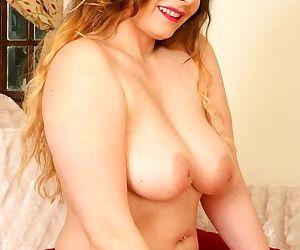 Hot busty curvy milf rubs her twat