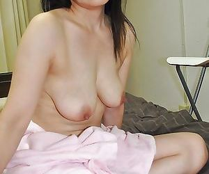 Akiko Oda plays with a vibrator and gets her hairy cunt nailed tough