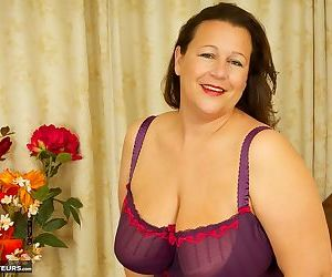 Older BBW frees huge boobs from lingerie before pussy play in sheer nylons