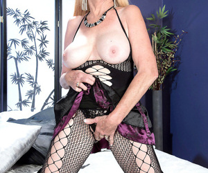 Busty granny charlie spreading in fishnet pantyhose and latex bo - part 768