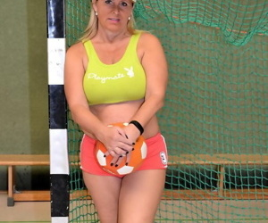 Busty mature fatty gets fitness coaching while stark naked in the school gym