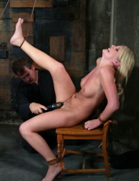 Busty females Lacie Hart & Sasha Sparks are restrained and tortured in dungeon