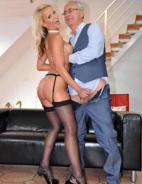Blonde MILF slut in stockings & garter bends over for oldman cock