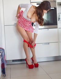 Hot teen girl Gloria Sol takes off all of her clothes in the kitchen