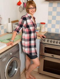 Hot amateur in glasses sits on the kitchen counter for topless panty upskirt