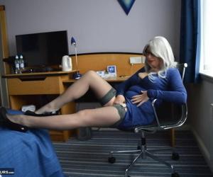 Mature blonde Barby Slut masturbates after disrobing in a mirror
