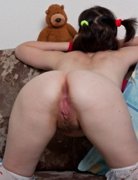 Naughty teen girl shows off her beaver to the delight of her plush toys