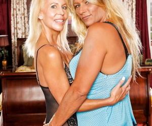 Leggy older blondes Debi Diamond and Erica Lauren strip down to lingerie