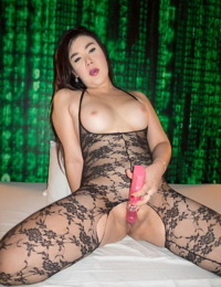 Chubby big breasted Ladyboy Anny in lace lingerie uses a vibrator on her pussy