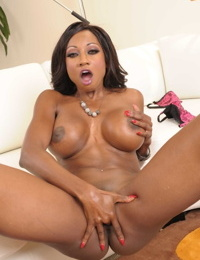 Arousing black babe Diamond Jackson plays around with her desirable pussy