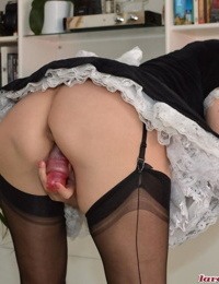 Mature French maid sticks a toy in her ass while masturbating on the job