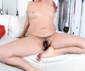 Blonde chick Alicia Silver wears her hair in a braid while showing her bush