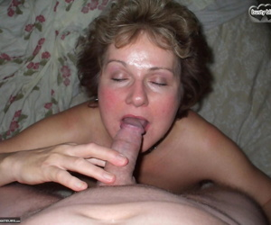 Mature lady Busty Bliss peels off pantyhose before pleasuring a cock POV style