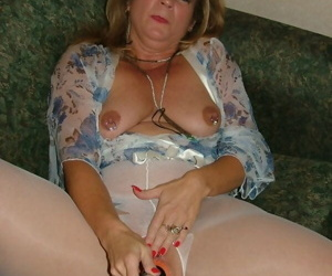 Mature fatty Devlynn toys her pussy wearing crotchless pantyhose