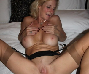 Mature amateur exchanges oral sex when not modeling in nylons on her bed