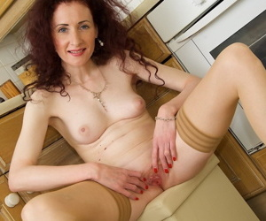Tall thin mature Scarlet Martini doffs lace lingerie in the kitchen & spread