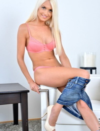 Good-looking blonde Lena Love takes clothes off as she wants to masturbate