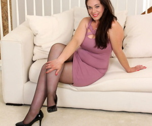 Older plumper Katrina Sobar masturbates with a vibrator after undressing
