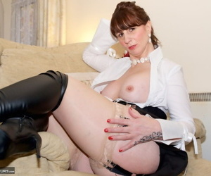Busty hot mature strips her sexy clothes to fondle firm big tits wearing boots