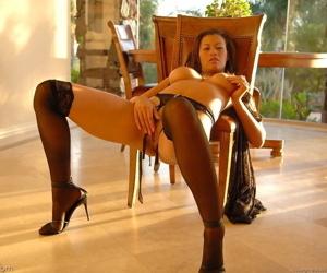 Long legged brunette Celeste pleasing herself in sexy black lingerie