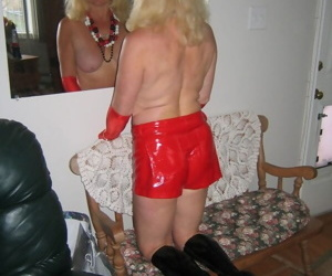 Hot older blonde Ruth works free of pleather wear to pose nude in boots
