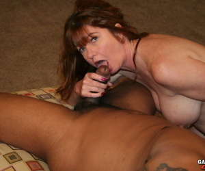 Mature woman Dee Delmar and a gf share a big black dick during a threesome