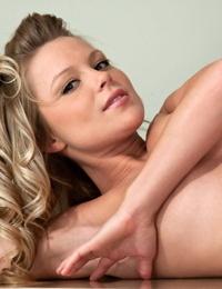 Amateur model Meet Madden looks cute teasing in sun dress & thong on the desk