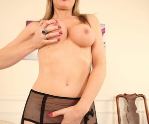 UK model Sofia Rae cups a breast in garters and back seam nylons