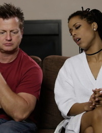 Young ebony slut Kira Noir talking to her husband in her bathrobe