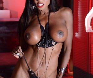 Black chick Diamond Jackson teasingly works free of leather bikini