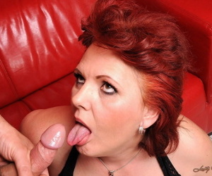 Redhead granny Caitlin open her pussy lips and receives a rough banging