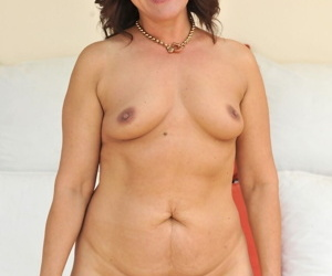 Redhead fatty Red Mary frees saggy big tits & show off hairy snatch naked