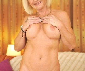 We all know that this blonde granny Anett looks so sexy in her lingerie